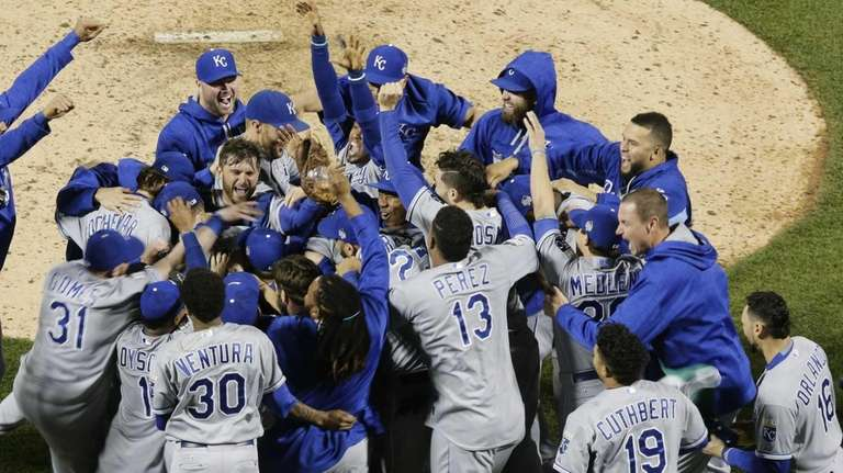 Members of the Kansas City Royals celebrate after
