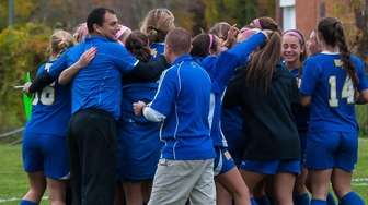 The West Islip girls soccer team celebrates their