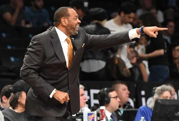 Brooklyn Nets head coach Lionel Hollins reacts against