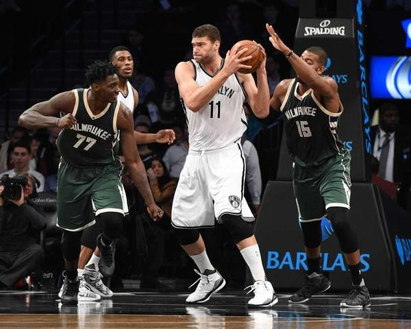 Brooklyn Nets center Brook Lopez grabs a rebound
