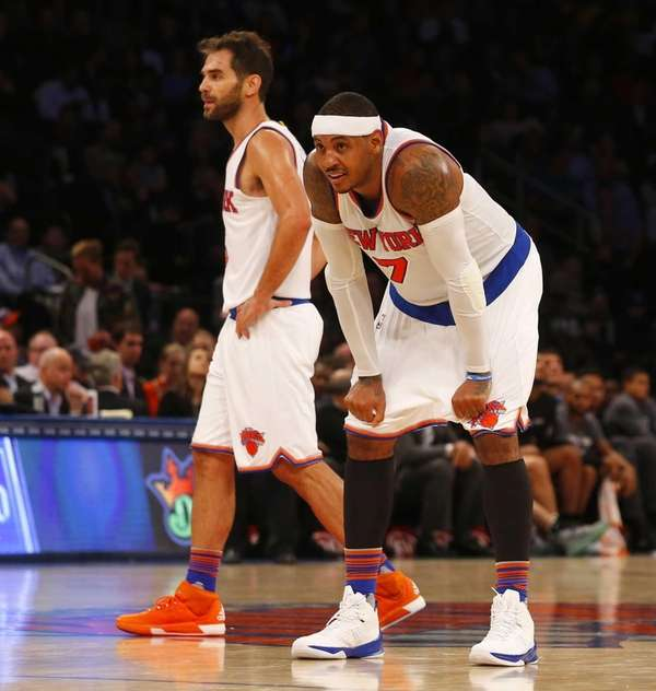 Carmelo Anthony #7 and Jose Calderon #3 of