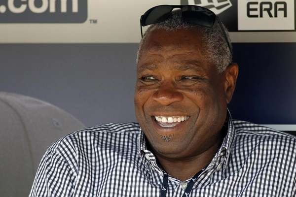 Dusty Baker sits in the Atlanta Braves dugout