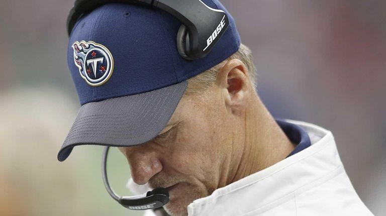 Tennessee Titans head coach Ken Whisenhunt looks down