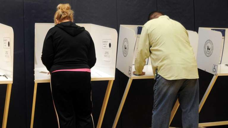 Voters cast their vote at the Bayport-Blue Point