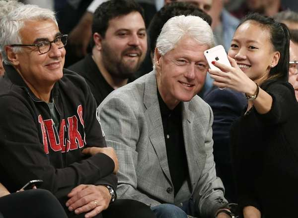 Milwaukee Bucks owner Marc Lasry, left, smiles as