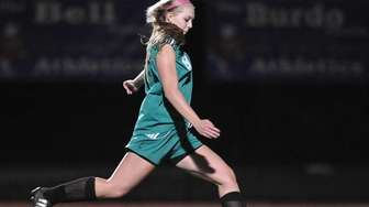 Carle Place's Carly Ackerina scores on a penalty