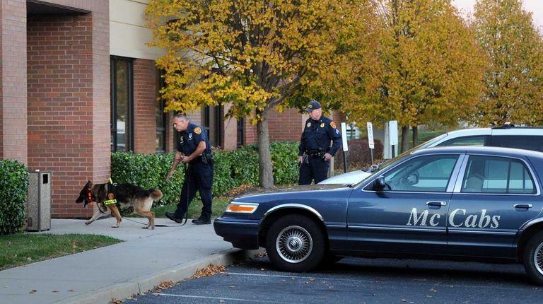 Investigators at the scene of a homicide at