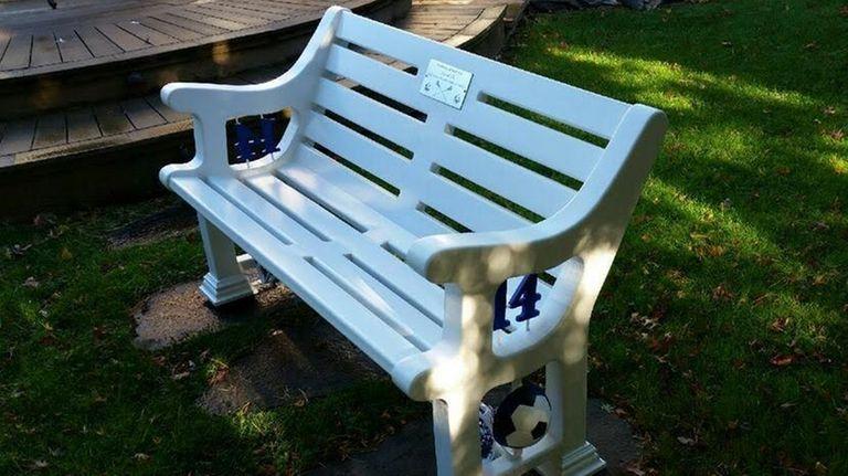 A memorial bench for Sean Urda, a John