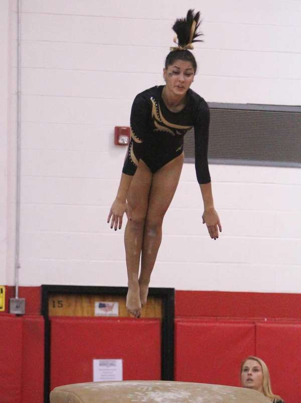 Lauren Gomes of Commack competes on the vault