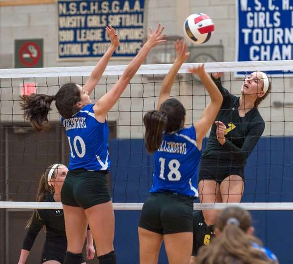 Kellenberg girls volleyball player Kate Calabro (10, left),