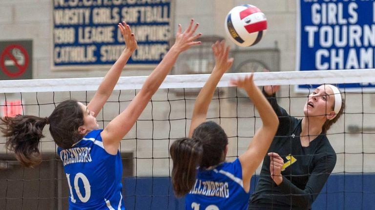 Kellenberg girls volleyball player Kate Calabro (10, left),