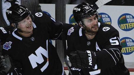 New York Islanders center Casey Cizikas is congratulated