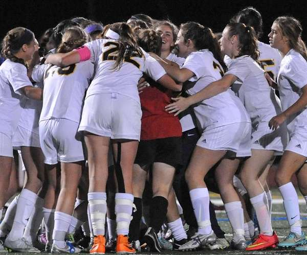 Massapequa teammates celebrate after their 3-2 win over