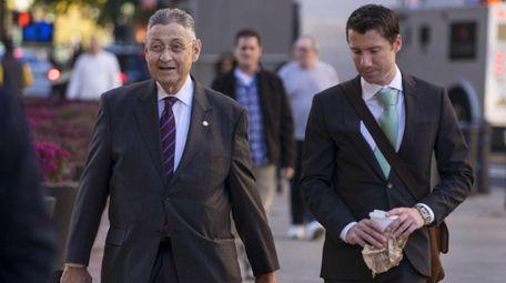 Former State Assembly Speaker Sheldon Silver, left, arrives