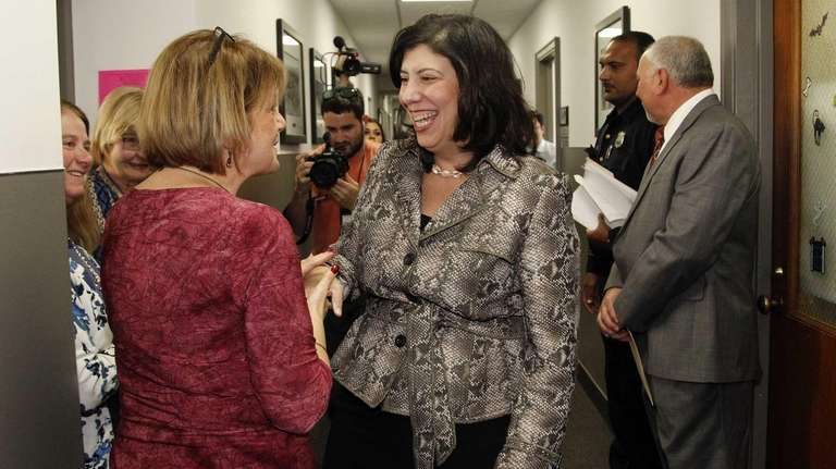 Acting Nassau District Attorney Madeline Singas is greeted