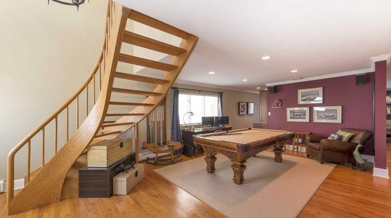 The Spiral Staircase In This Bellmore House Ascends
