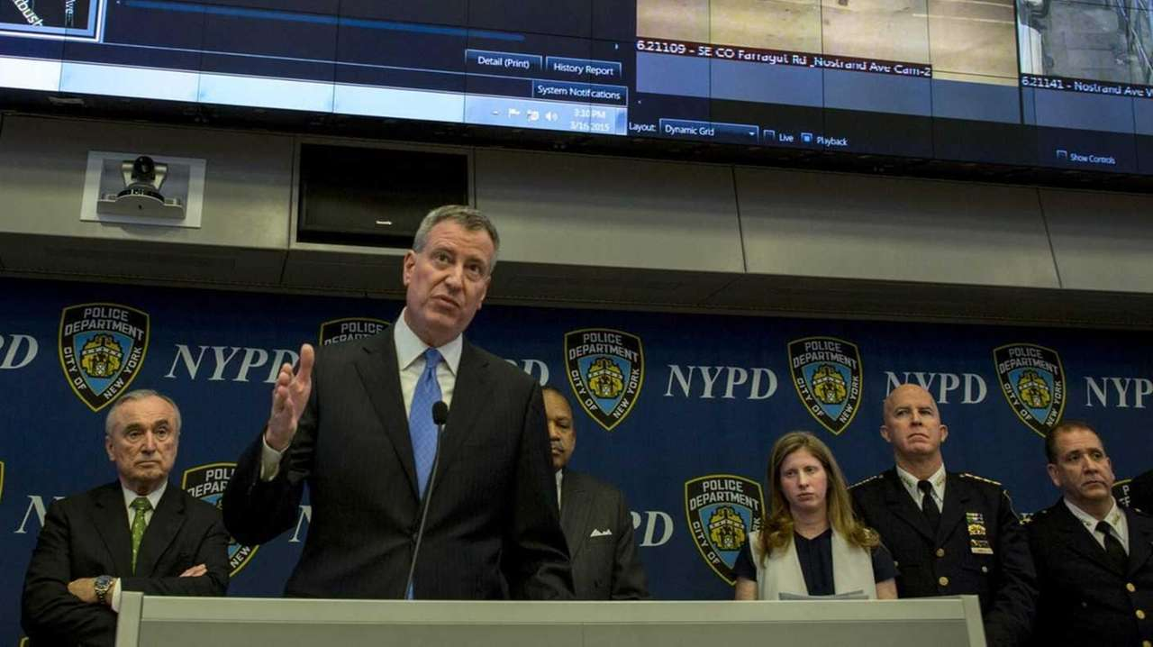 Mayor Bill de Blasio, at podium, and Police