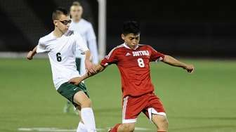 Edwin Martinez of Southold dribbles the ball away