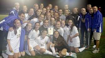 The West Islip girls soccer team poses with