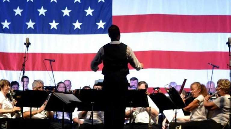 The Atlantic Wind Symphony plays a salute-to-the-troops concert
