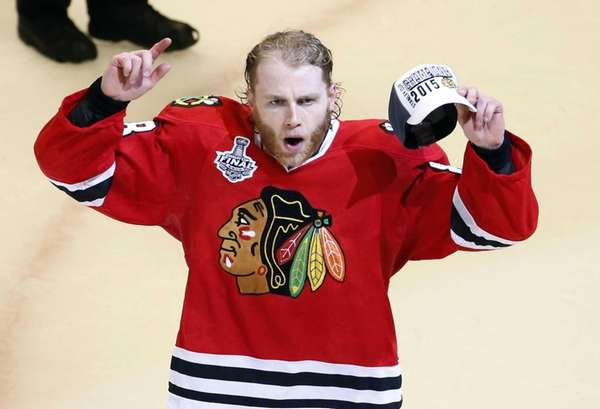 Chicago Blackhawks' Patrick Kane celebrates after defeating the