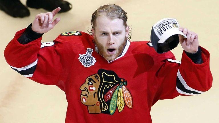 Chicago Blackhawks' Patrick Kane celebrates after defeating the