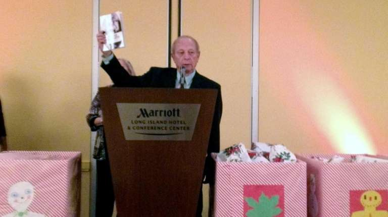 Hal Laufer presents two $1,000 scholarships during the