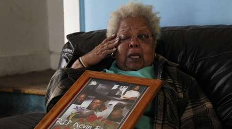 Marcella Brown holds a photo of her son