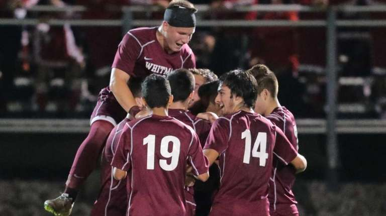 Walt Whitman players surround Witman Hernandez after he