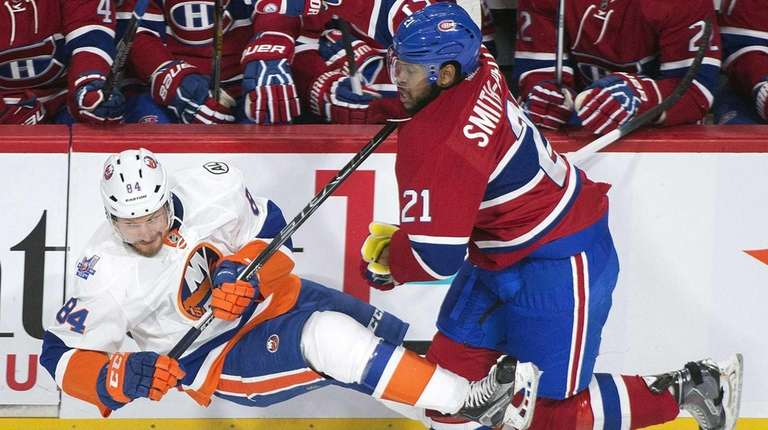 Montreal Canadiens' Devante Smith-Pelly, right, collides with New