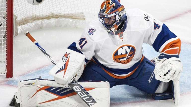 New York Islanders' goaltender Jaroslav Halak makes a