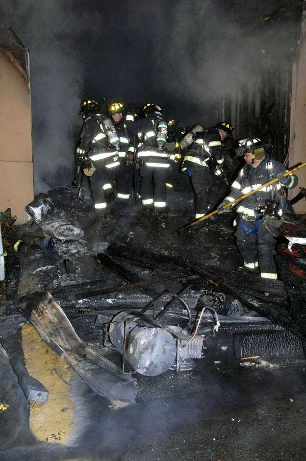 Firefighters at the scene after a fire broke
