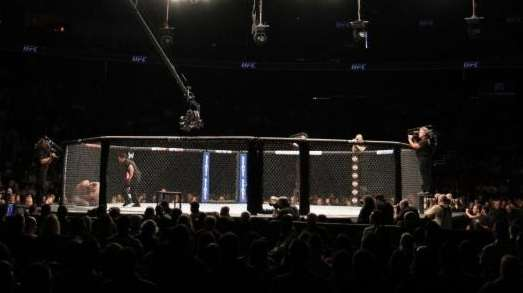 UFC fighters grapple in the the Octagon at