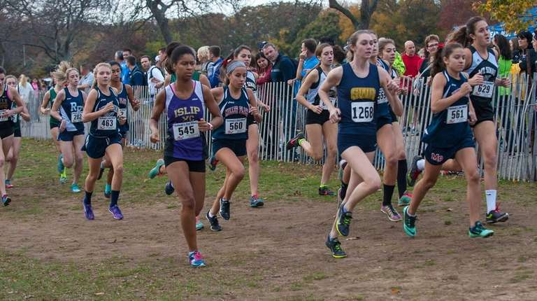 Girls cross country runners take off at the