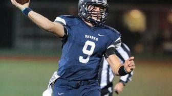 Eastport-South Manor quarterback Matt Kane #9 scrambles in