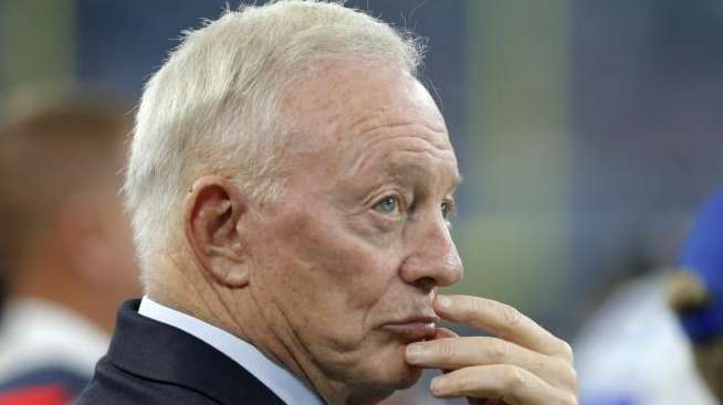 Dallas Cowboys owner Jerry Jones stands on the