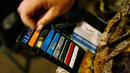 Ileana Garcia looks in her wallet for credit
