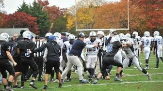 A bench-clearing brawl breaks out during a Suffolk