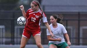 Center Moriches No. 12 Catherine Nolan, left, keeps