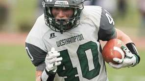 Westhampton Beach's Dylan Laube (40) runs the ball