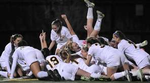 Massapequa teammates celebrate after their 3-0 win over