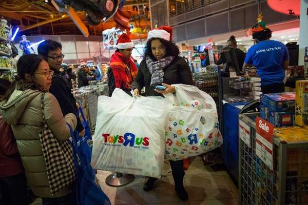 A woman shops at the Toys R Us