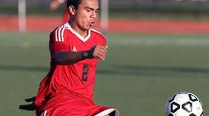 Amityville's Kevin Medrano keeps control during the Long