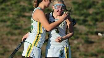 Kassidy Rogers-Healion #3 is congratulated by teammates after