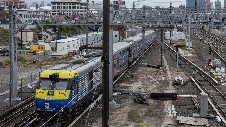 An LIRR train rolls through the Harold Interlocking