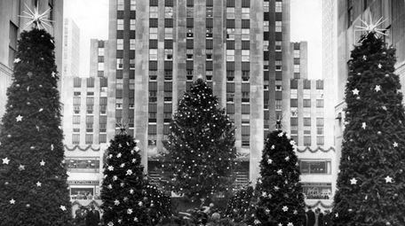 Holiday lights adorn the 1943 Rockefeller Center Christmas