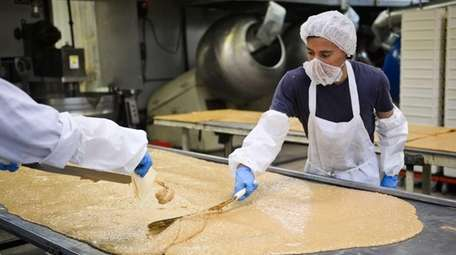 Employees process English toffee inside the Nassau Candy