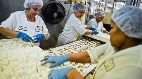 Employees process caramel chocolate candy inside the Nassau