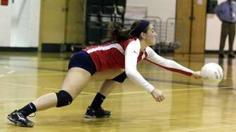 Smithtown's Morgan Catalonatto (15) goes for the dig
