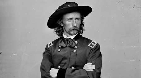 George Armstrong Custer poses in the uniform of